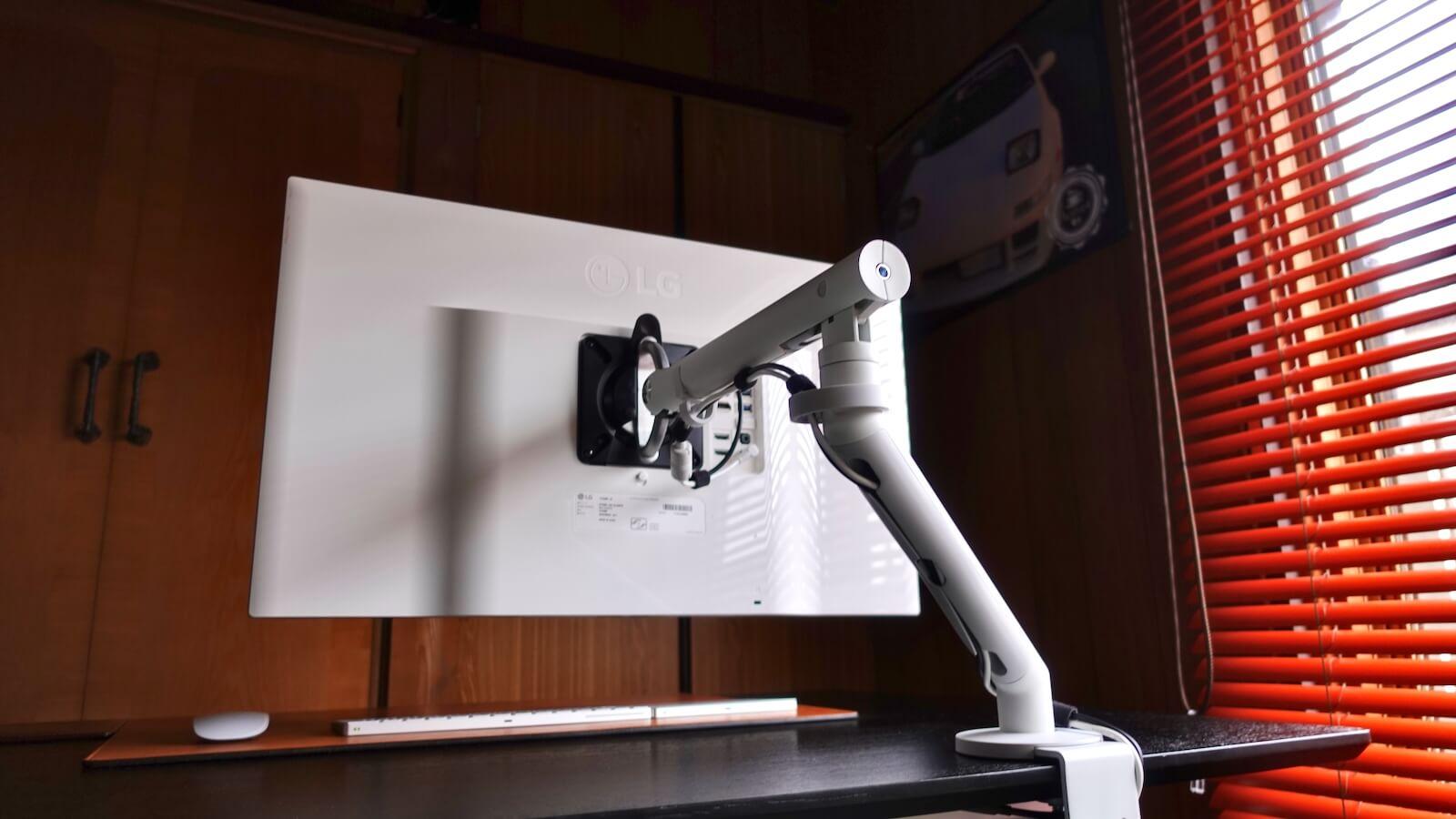 HermanMiller FLO monitor arm white monitor back