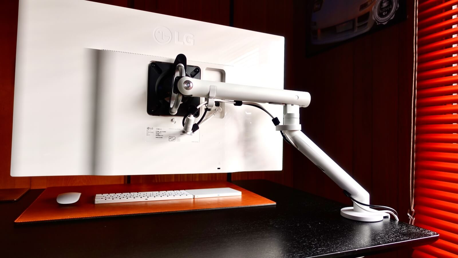 Herman Miller Flo monitor arm installed at the left end of the arm table
