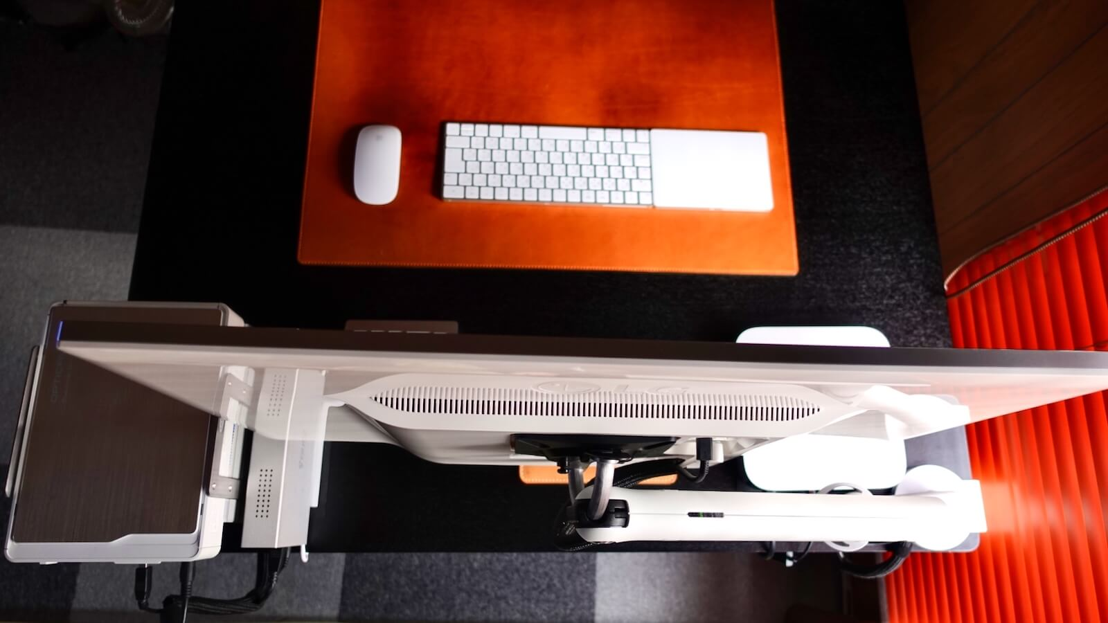 Herman Miller Flo Monitor Arm installed on the left edge of the table